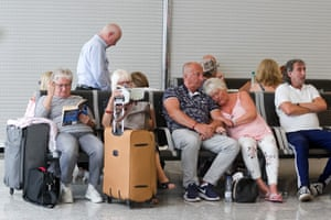 British passengers waiting for news on cancelled Thomas Cook flights at Palma de Mallorca airport today.