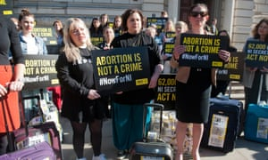 Women who have been affected by Northern Ireland's strict abortion laws protest in Westminster.