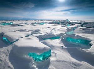 Snow hummocks with the ice backlit by the midday sun at Lake Baikal in Siberia