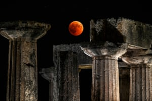 The full moon sits over the temple of Apollo in Corinth, Greece.