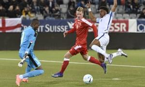 England Under-21s goalscorer Chuba Akpom challenges for the ball with Switzerland goalkeeper Yvon Mvogo and defender Nico Elvedi