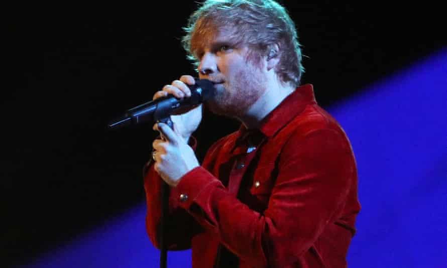 Ed Sheeran performs at a concert.
