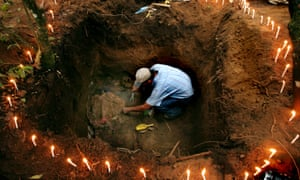 A forensic anthropologist works to exhume the body of a peasant killed by the Guatemalan Army in 1982 during the country's civil war.