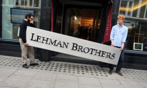 A Lehman Brothers sign is removed