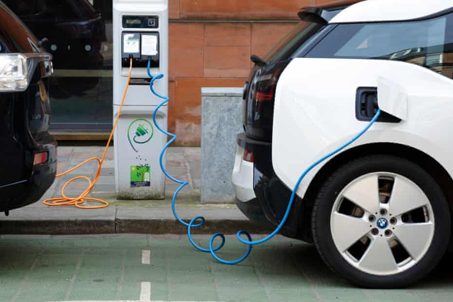 Two electric cars charging in Glasgow.