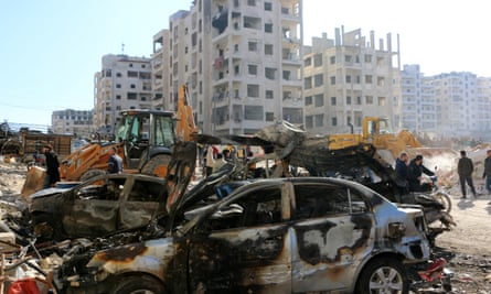 Damages cars and buildings in Idlib, Syria