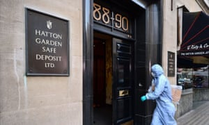 A police forensics officer entering the Hatton Garden Safe Deposit company in London after the 2015 raid.