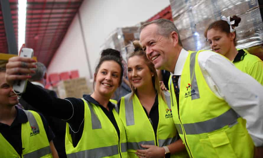 Bill Shorten with workers during a visit to Australian Container Freight Services in Brisbane on Thursday.
