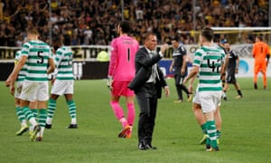 Brendan Rodgers goes to the shake the hand of Calum McGregor after Celtic were knocked out of the Champions League by AEK Athensa