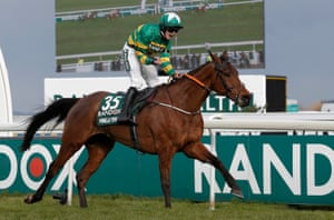 Rachael Blackmore on Minella Times pass the winning post to claim their historic victory.