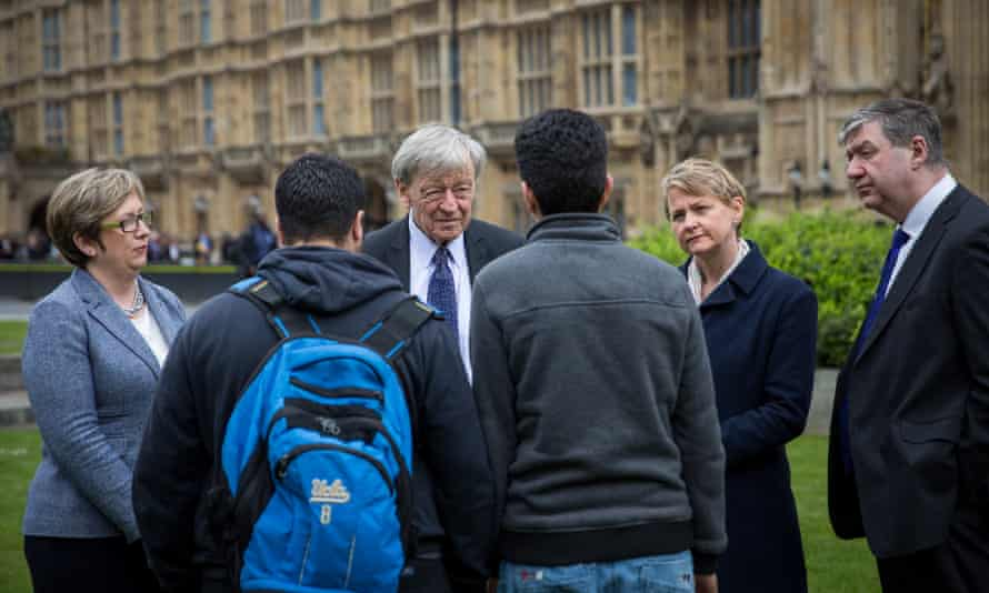 Cherry, Dubs, Cooper and Carmichael speaking to two child refugees