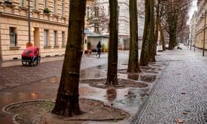 A lone jogger in a deserted street in Berlin's Schoeneberg district