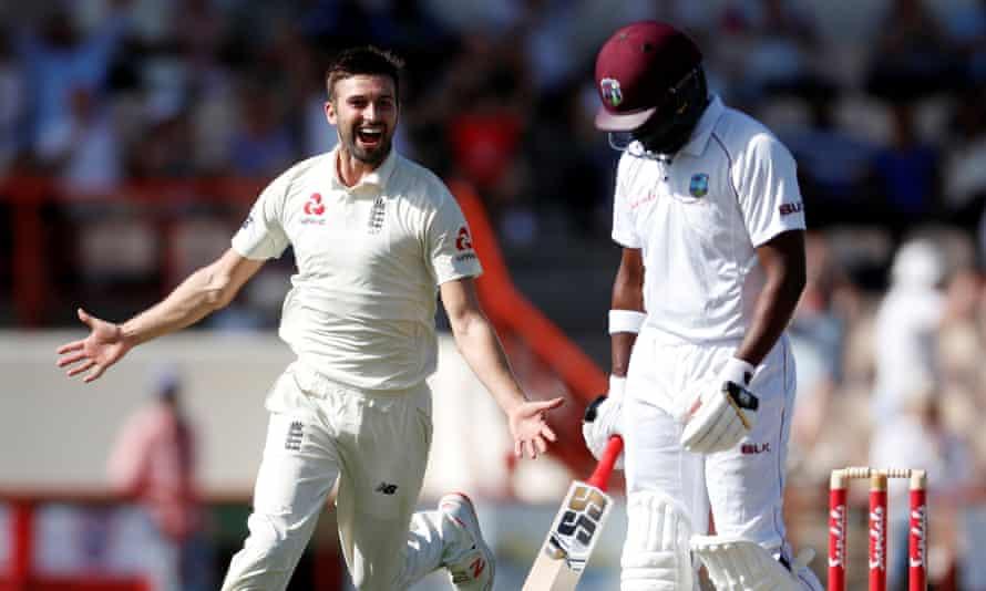 Mark Wood celebrates taking the wicket of Darren Bravo