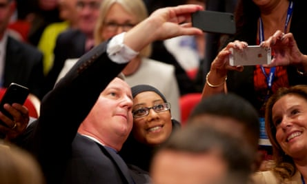 David Cameron posing for selfies with delegates at last year's Conservative conference