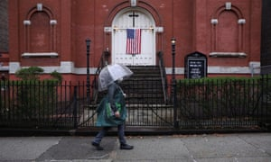A man walks past a closed church in Brooklyn, New York