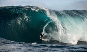 """Chris Ross surfing. Daredevil surfers off the coast of Western Australia enjoyed perfect conditions – with waves as high as 60ft – on a right-hand break known as """"The Right"""" between June 26-28, 2015. It was considered a once in a decade swell and was caused by a low-pressure system over the Indian Ocean. Photo by Russell Ord."""