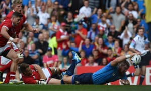 Italy prop Michele Rizzo scores a try