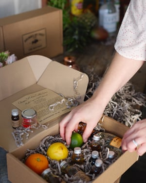 Cocktail kit containing bottles and fruit