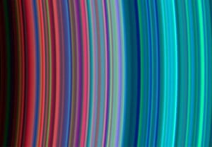 30 June 2004 This image shows (left to right) the outer portion of Saturn's C ring and inner portion of its B ring. The general pattern is from 'dirty' particles indicated by red to cleaner ice particles shown in turquoise. The ring system begins from the inside out with the D, C, B and A rings followed by the F, G and E rings. This image was taken with the ultraviolet imaging spectrograph instrument, which is roughly 100 times the resolution of ultraviolet data obtained by the Voyager 2 spacecraft