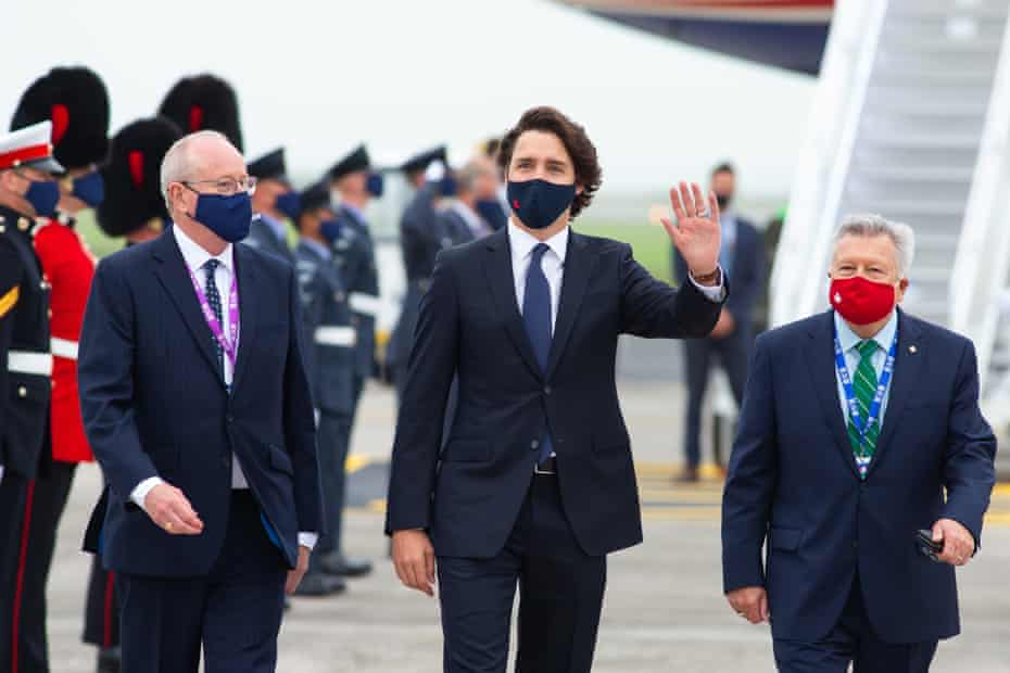 Justin Trudeau, Prime Minister of Canada, waves to the media on arrival at Newquay Airport.