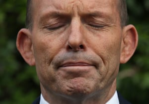 Australian Prime Minister Tony Abbott pauses while speaking to the media during a press conference after attending a NAIDOC meeting to consider the model for a referendum on indigenous recognition in Kirribilli.