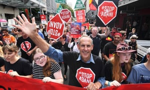 Former Greens leader Bob Brown leads a protest march against Adani's Carmichael coalmine through Brisbane