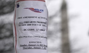 A police sign near the White House reminds visitors of the capital's strict firearms laws.