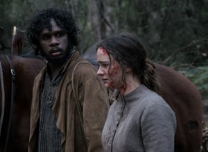 Baykali Ganambarr as Billy and Aisling Franciosi as Clare.