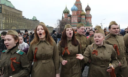 Kremlin-backed youth movement activists sing at an anti-Putin protest in 2012 in Moscow.