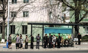 Residents of the North Korean capital wait for a bus, in Pyongyang, North Korea.