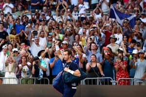 Andy Murray arrives on court and acknowledges the fans prior to his first round match against Roberto Bautista Agut of Spain
