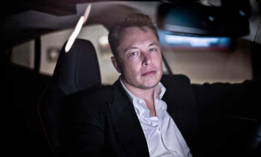 Elon Musk inside one of his company's electric cars in London.