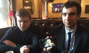 Alexei Stolyarov, left, and Vladimir Kuznetsov in Moscow show video of their prank on Ukrainian oligarch Ihor Kolomoisky.