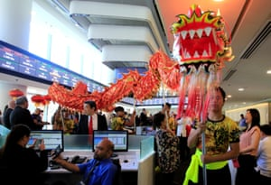Traders watch a traditional dragon dance during the opening bell ringing to mark the first trading day at the brand new Philippine Stock Exchange complex in Bonifacio Global city at Metro Manila.