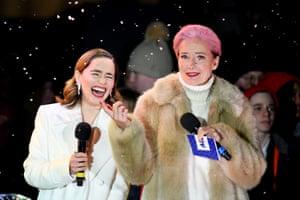 London, UK. Emilia Clarke and Emma Thompson switch on the Covent Garden Christmas lights