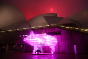 The Hero Pig Lantern by artist Qian Jian Hua is illuminated on the western boardwalk of the Sydney Opera House