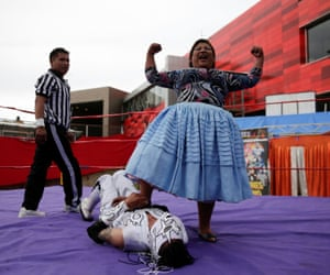 Silvana La Poderosa, a cholita wrestler, reacts after winning a fight during their return to the ring in El Alto outskirts of La Paz.