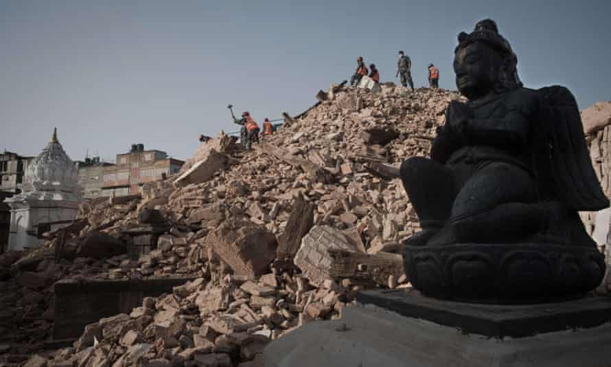Nepalese police clear rubble at the Narayan temple in Kathmandu.