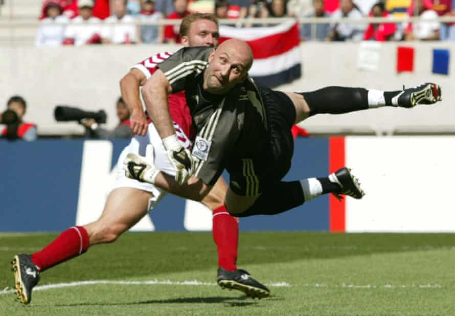 France's Fabien Barthez watches in mid air as Dennis Rommedahl's shot hits the back of the net to give Denmark the lead.