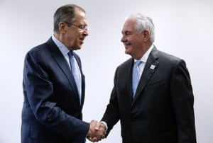 Russian foreign minister Sergei Lavrov and US secretary of state Rex Tillerson shake hands in Bonn.