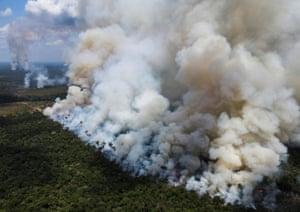 Smoke from burning vegetation rises in the Brazilian Amazon rainforest near the Trans-Amazonian highway in Amazonas state.