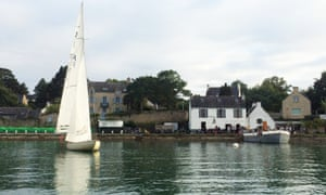 View of  Chez Charlemagne from opposite river bank, yacht on water, Ile aux Moines, France.