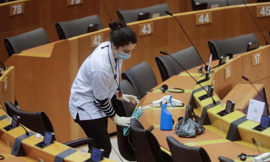 Seats and desks in the European Parliament in Brussels are sanitised.