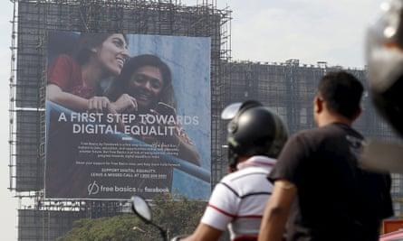 Motorists ride past a billboard displaying Facebook's Free Basics initiative in Mumbai, India, December 30, 2015.