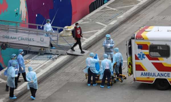 A man disembarks the World Dream cruise ship.