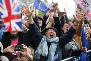 EU supporters cheer after the result of the vote on the deal delay was announced at the House of Commons.