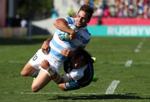 Nicolas Sanchez of Argentina goes over to score his side's first try .