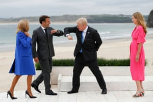 The Johnsons greet the president of France, Emmanuel Macron, and his wife, Brigitte, during arrivals for the G7 meeting in Cornwall