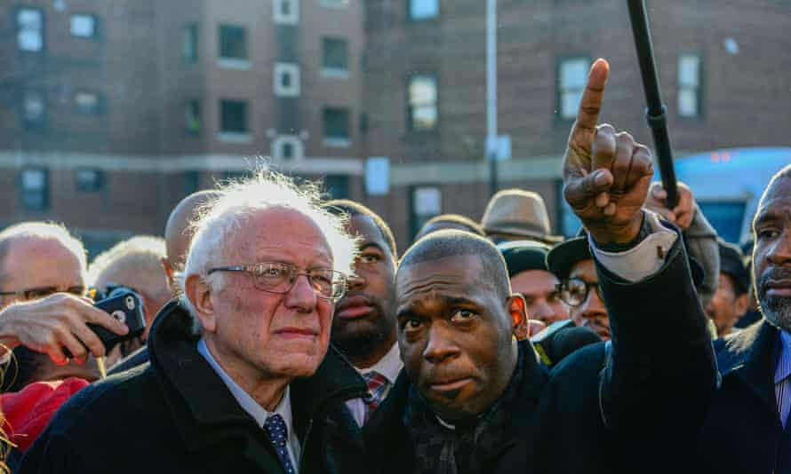 The Rev Jamal Bryant points as Sanders looks on.