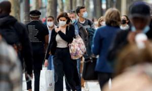 People wearing protective face masks in Paris last week